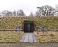 The entrance is seen at a former Regional Government HQ Nuclear bunker built by the British government during the Cold War which  has come up for sale in Ballymena, Northern Ireland on February 4, 2016. It is owned by the Office of Northern Ireland's First Minister and Deputy First Minister and capable of accommodating 236 personnel for extended periods. A large range of the original fixtures and fittings are to be included in the sale. It is believed to be one of the most technically advanced bunkers built in the UK with an array of advanced life support systems. In the event of a nuclear attack, the building could operate in a shut-down capacity for 30 days. The lower floor is completely underground and the upper floor is mounded over with 1 cubic metre of earth.  REUTERS/Clodagh Kilcoyne