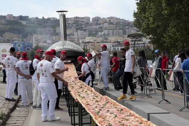 NAPLES, ITALY - MAY 18:  Pizza makers attempt to break the Guinness World Record for the longest   in the world on the seafront of Naples, Italy on May 18, 2016. The goal is to reach 2000 meters and beat it the Guinness World Record of 1,5 km achieved last year at Expo in Milan. (Photo by Stringer/Anadolu Agency/Getty Images)