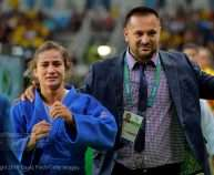 RIO DE JANEIRO, BRAZIL, AUGUST 07:  Emotional gold medallist, Majlinda Kelmendi of Kosovo is guided from the mat by her coach, Tritton Kuka, after the u52kg final on day 2 of the 2016 Rio Olympic Judo on Sunday, August 07 held at the Carioca Arenas, Barra, Rio de Janeiro, Brazil. (Photo by David Finch/Getty Images) *** Local Caption *** Majlinda Kelmendi;Tritton Kuka