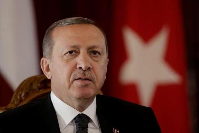 Turkey's President Recep Tayyip Erdogan speaks during a news conference in Riga October 23, 2014. REUTERS/Ints Kalnins (LATVIA - Tags: POLITICS HEADSHOT) - RTR4BAG2