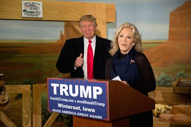 WINTERSET, IA - JANUARY 19: Republican presidential candidate Donald Trump looks on as he receives the endorsement of Aissa Wayne, John Wayne's daughter, at the John Wayne Birthplace Museum on January 19, 2016 in Winterset, Iowa. Trump is making a campaign swing through Iowa before it's crucial first in the nation caucus. (Photo by Aaron P. Bernstein/Getty Images)