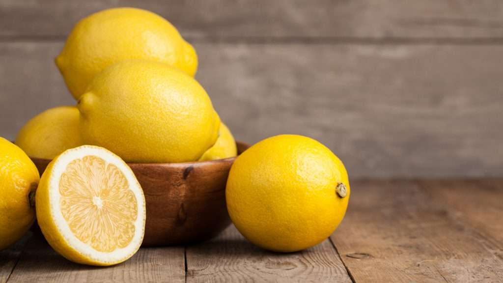 Group of fresh lemon on an old vintage wooden table; Shutterstock ID 289188959; PO: today.com